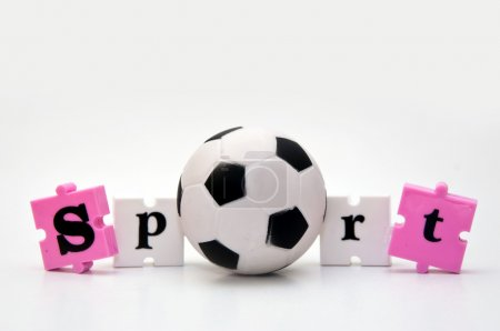 Photo for Small soccer ball and a word puzzle pieces forming a word Sport - Royalty Free Image