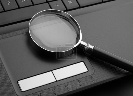 Photo for Magnifying glass on laptop computer - Royalty Free Image
