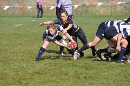 Player About to Pass the Ball After a Scrum in a Women