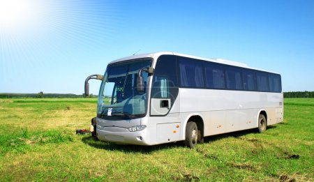 Photo for Modern grey coach in a field - Royalty Free Image