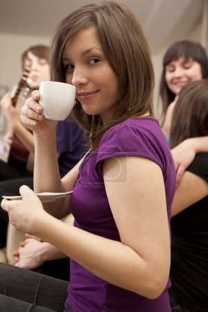 Woman with coffee on friends meeting