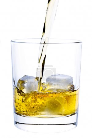Photo for Whiskey pouring into a glass isolated on white - Royalty Free Image