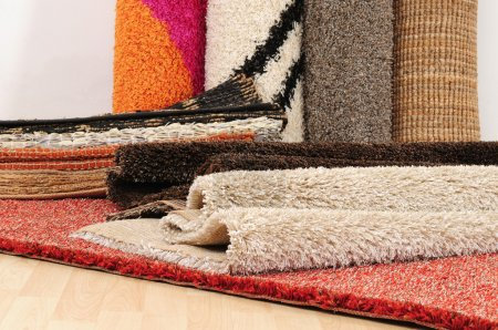 Photo for Hand made rugs on wooden floor. - Royalty Free Image