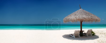 Photo for Beach Chairs and Umbrella on a beautiful island, panoramic view with much copy space - Royalty Free Image