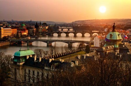 Panoramic view on Charles bridge and sunset Prague lights. Bohemia, Czech R