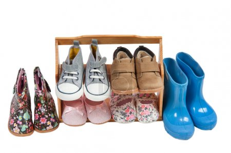 Shelf of children shoes for all seasons isolated on white