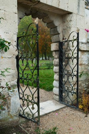 Romantic fence gate leading to rose garden