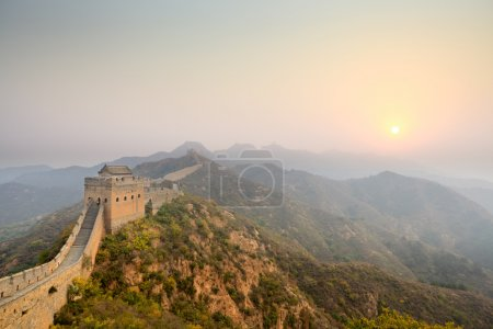 The great wall winding at sunrise