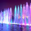 Colored water fountain at night...