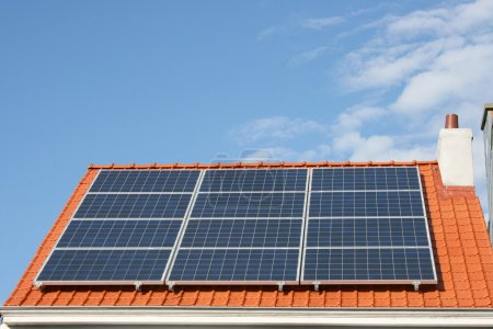 Photo for Solar panels on a house roof - Royalty Free Image