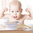 Happy baby meal: cereal and milk. Concept: healthy...
