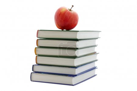 Photo for Apple on pile of books isolated on white - Royalty Free Image