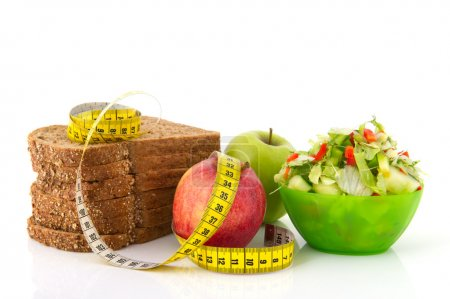 Photo for Healthy food for diet as bread fruit and vegetables with measurement tape - Royalty Free Image