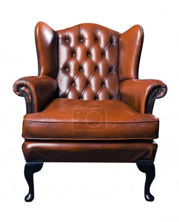 Old leather armchair on a white background