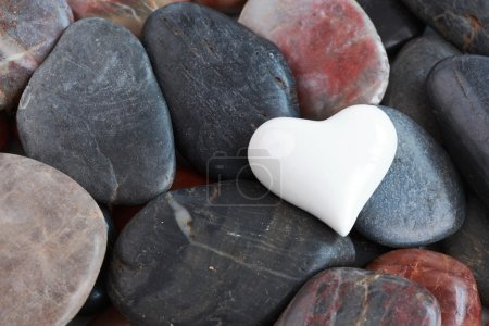 Photo for White heart heart surrounded by natural stones - Royalty Free Image
