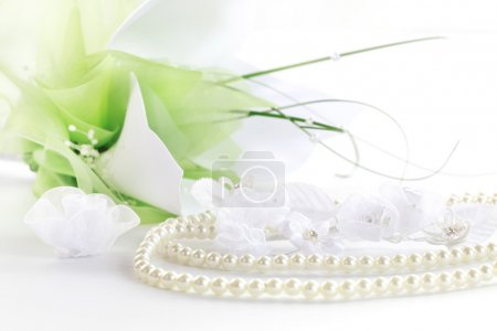 Photo for Wedding still life with necklace and bouquet in background - Royalty Free Image