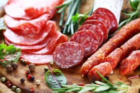 Different Italian ham and salami with herbs...