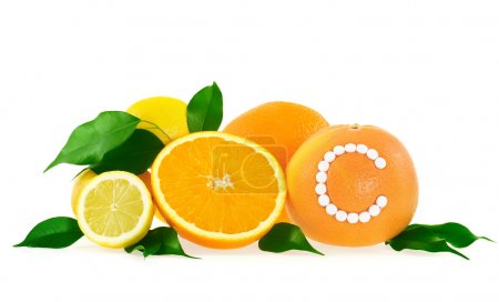 Orange, lemon, grapefruit with vitamin c pills over white background – citrus fruits concept
