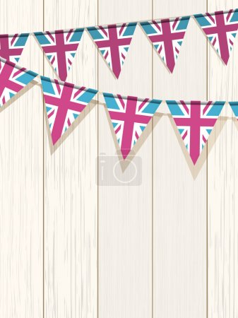 Union Jack bunting flags on a white wooden backgro...