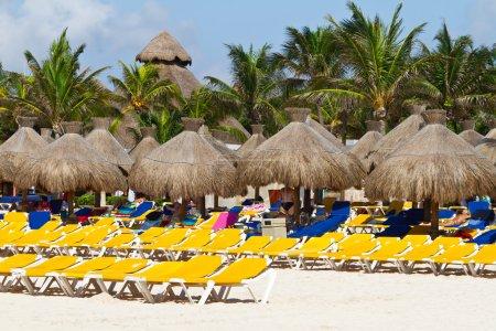 Deckchairs with parasols at Caribbean Sea