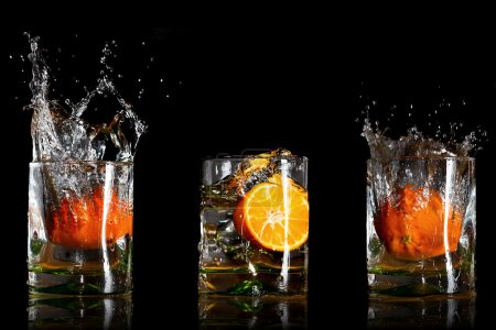 Splashing drinks with oranges