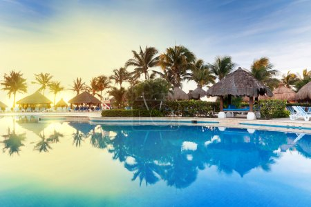 Tropical swimming pool at sunrise in Mexico...