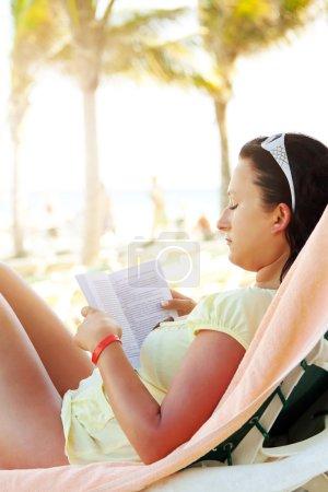 Reading book on the Caribbean beach