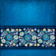 Abstract grunge blue background with blue spring floral ornament