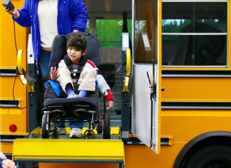 Disabled five year old boy using a bus lift for his wheelchair