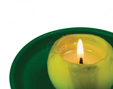 Green lit candle macro closeup, isolated glowing flame