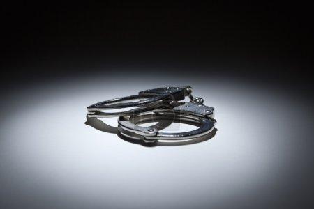 Abstract Pair of Handcuffs Under Spot Light
