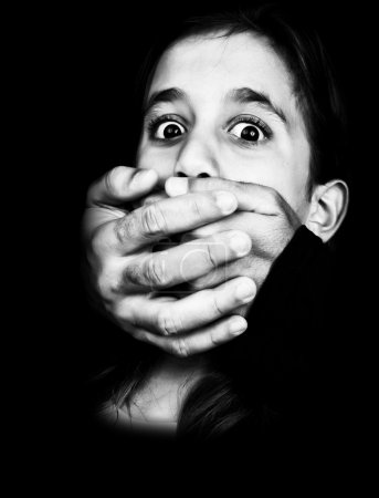 Black and white image of a child being abused and silenced
