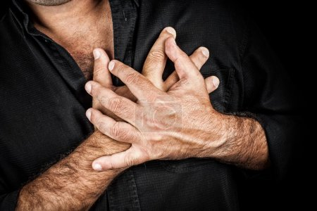 Close up of two hands grabbing a chest
