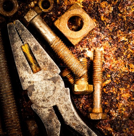 Macro of tools on a rusty background