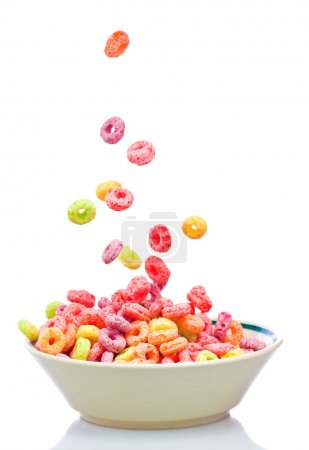 Photo for Colorful cereal falling on a bowl on a white background - Royalty Free Image