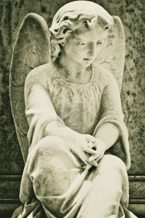 Vintage image of a beautiful angel on a cemetery