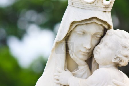 Beautiful marble statue of the Vigin Mary carrying the baby Jesus