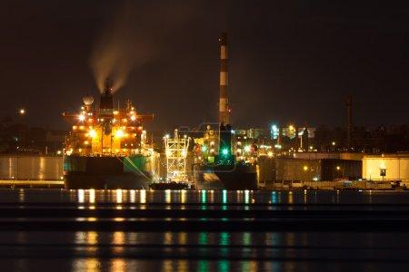 Oil tanker unloading cargo at night