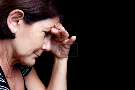 Older woman with a strong headache