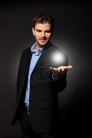 Photo for Young casual business man holding the answer to all the problems - Royalty Free Image