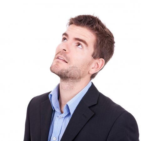 Photo for Young business man looking up on white background - Royalty Free Image