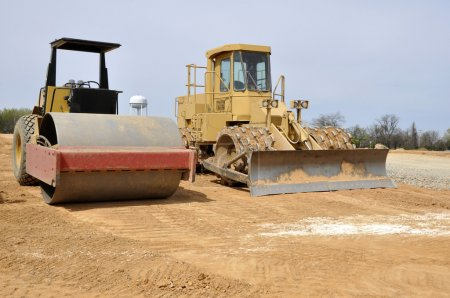 Photo for Road roller and compactor, types of heavy duty construction equipment used for excavation - Royalty Free Image