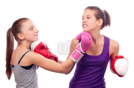 Pretty kick boxing teenage girls fighting isolated on white background