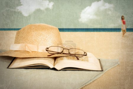 Vintage beach with book and