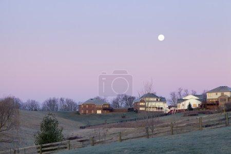 Moonset over a neighborhood