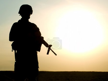 Photo for Silhouette of US soldier with rifle against a sunset - Royalty Free Image