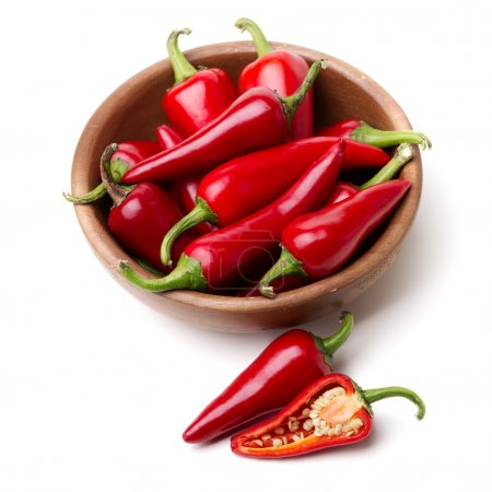 Photo for Red Hot Chili Peppers in bowl over white background - Royalty Free Image