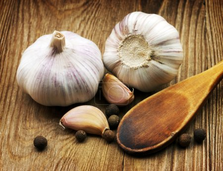 Photo for Garlic on rough chopping board - Royalty Free Image