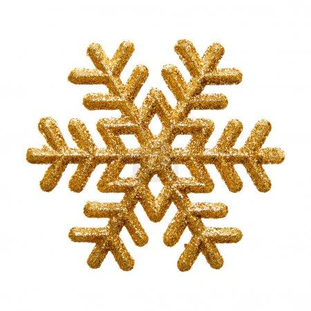 Foto de Brillo ornamental snowflake oro sobre fondo blanco puro - Imagen libre de derechos