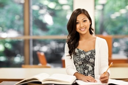 Photo for A shot of an Asian student studying in the library - Royalty Free Image